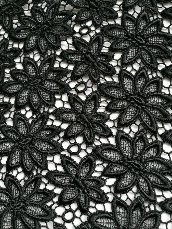 Spitze-Beschaffenheitshintergrund der Blume schwarzer stockbilder
