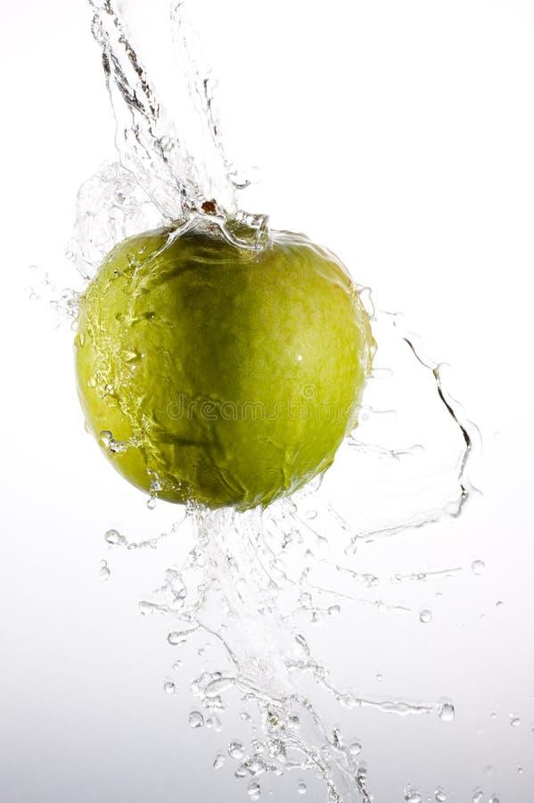 Splash apple royalty free stock photography