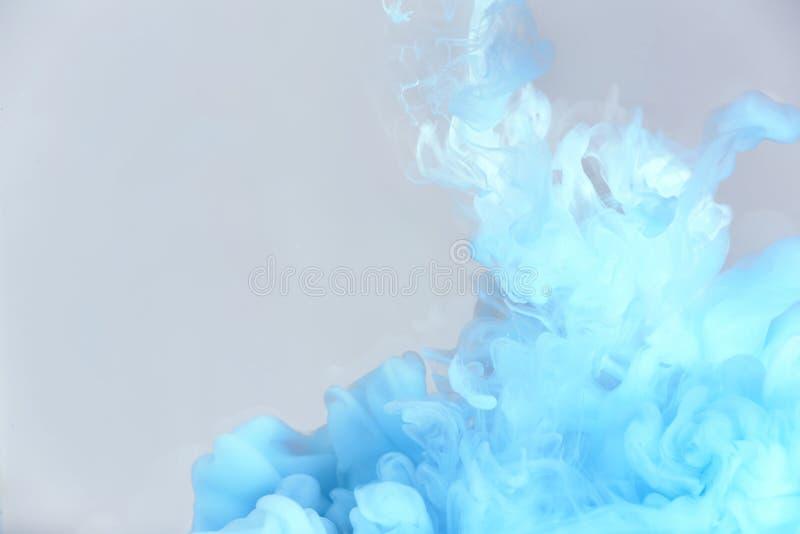 Splash of blue ink stock photo