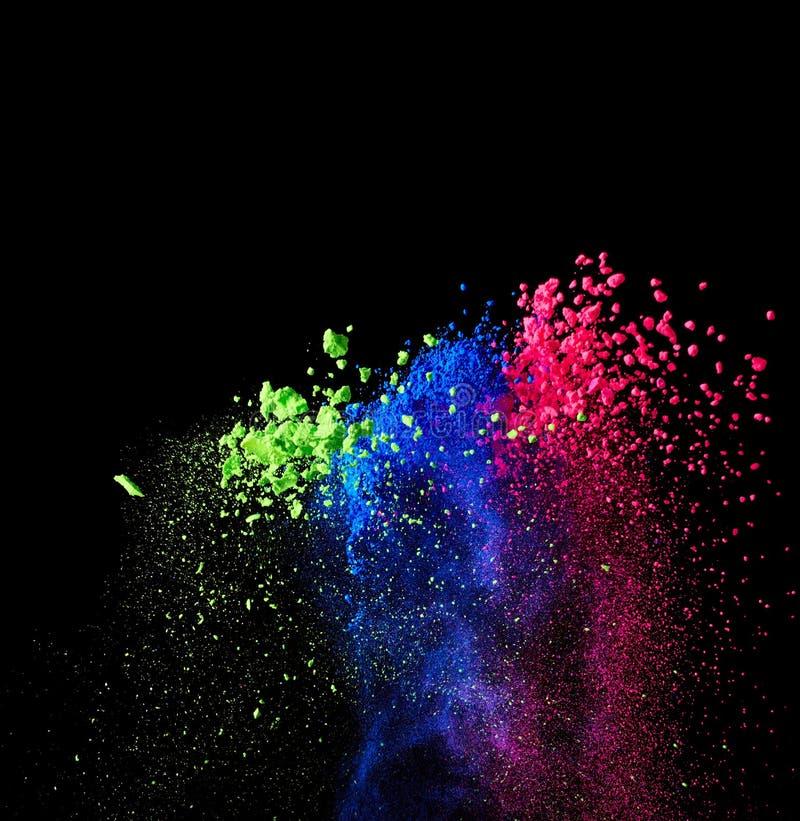 Splash of bright powder. On black background royalty free stock photography