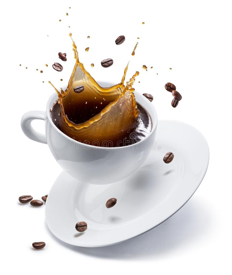 Splash of coffee in white cup and coffee beans in air. Isolated on white royalty free stock images