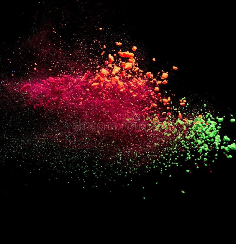Splash of colorful powder. On black background royalty free stock photos