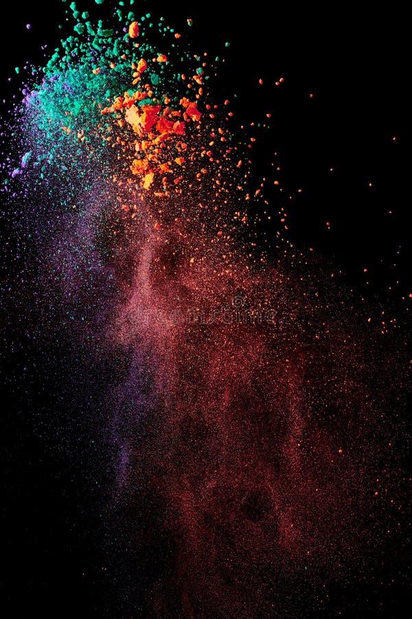 Splash of colorful powder. On black background royalty free stock photo