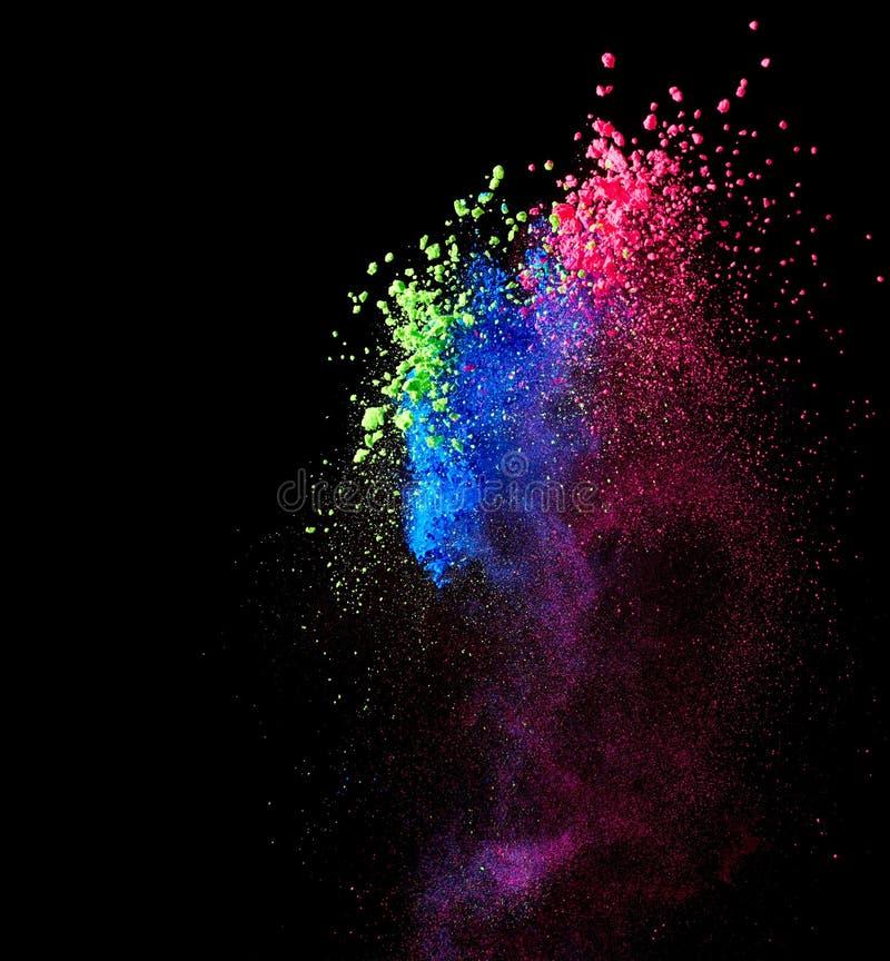 Splash of colourful powder. On black background royalty free stock photos