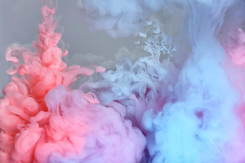 Splash of coral, light blue and pink inks royalty free stock photos