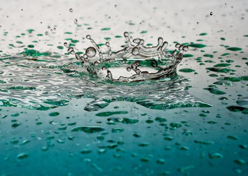 Splash Crown of Liquid. Falling on Glass stock photography