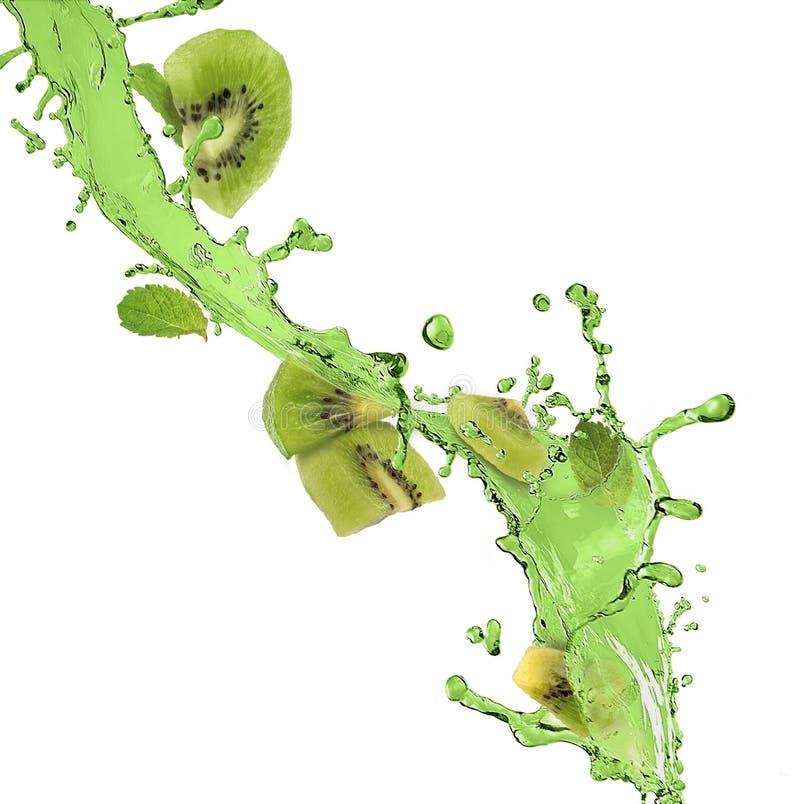 Splash of green juice and kiwi fruit. On a white background stock photo