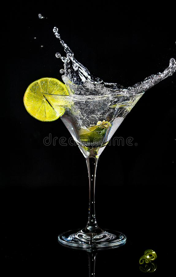 Free Splash Of A Cocktail In Martini Glass Royalty Free Stock Images - 106772919