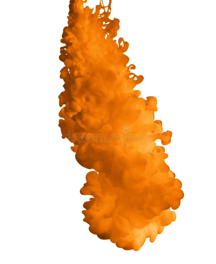 Splash of orange ink on white stock images