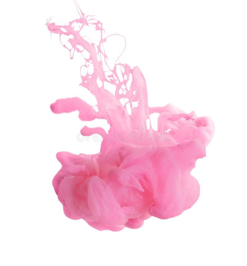 Splash of pink ink on grey stock image
