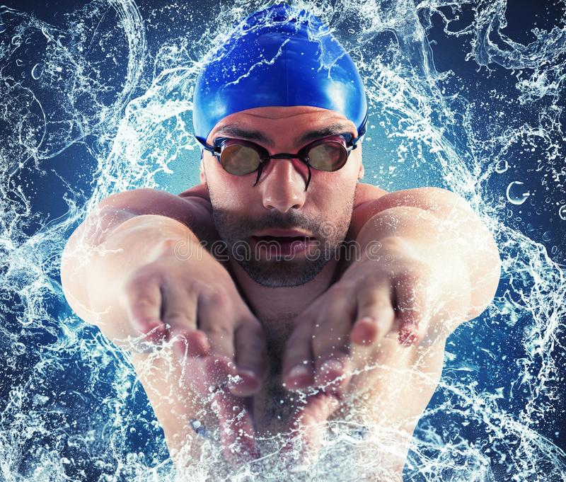 Splash professional swimmer. Professional swimmer enters the water with splash stock image