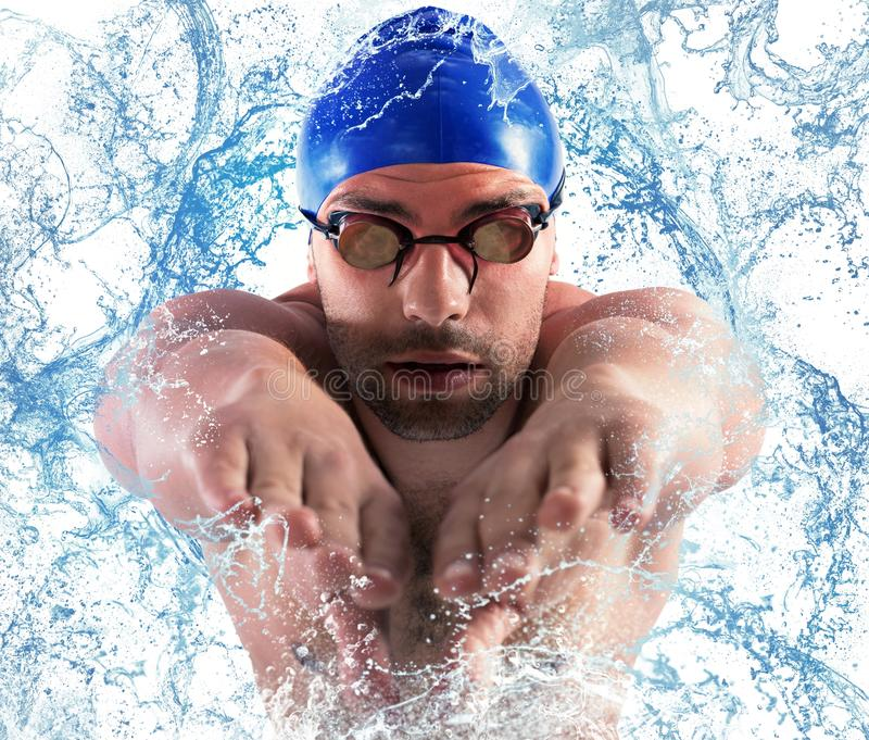 Splash professional swimmer. Professional swimmer enters the water with splash stock photography