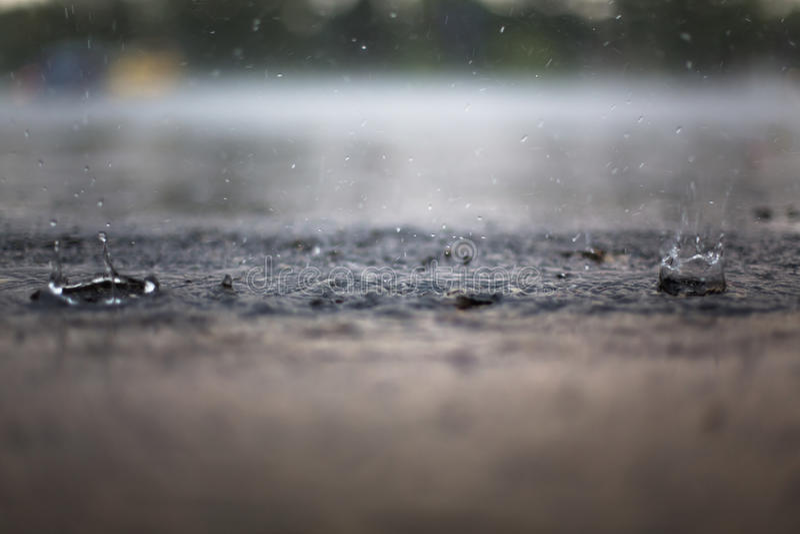 Splash of a Raindrop. Tight shot of a raindrop splashing upward during a storm royalty free stock photos