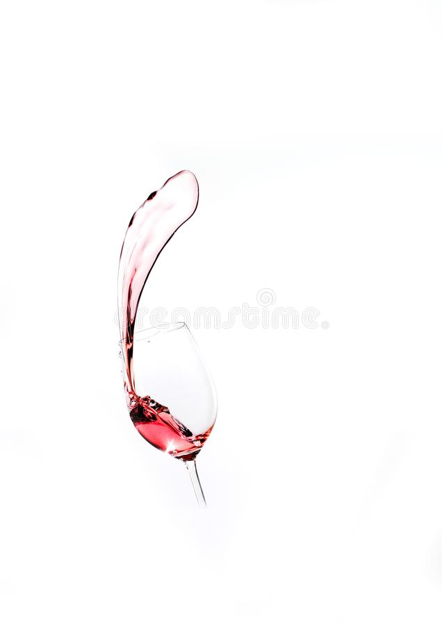 Splash of red wine from the glass. Splash of red wine from the wine glass, isolated on white background. Ready for party royalty free stock photos