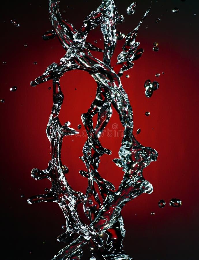 Splash streams. Beautiful splash streams on a red gradient background royalty free stock photos