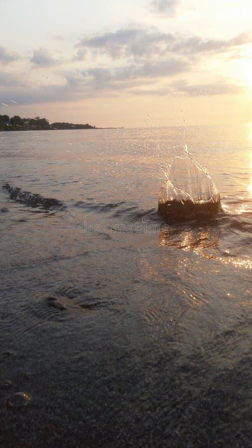 Splash in the sunset stock photos