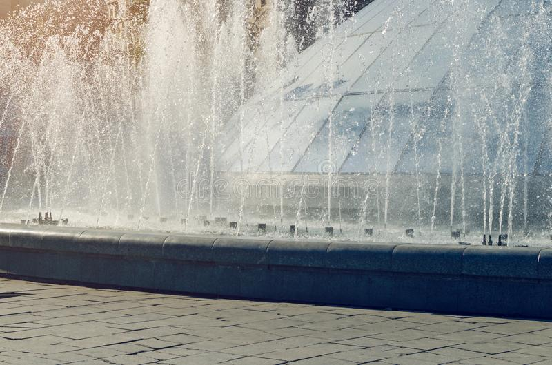Splash of water in a city fountain in the sunlight.  royalty free stock images