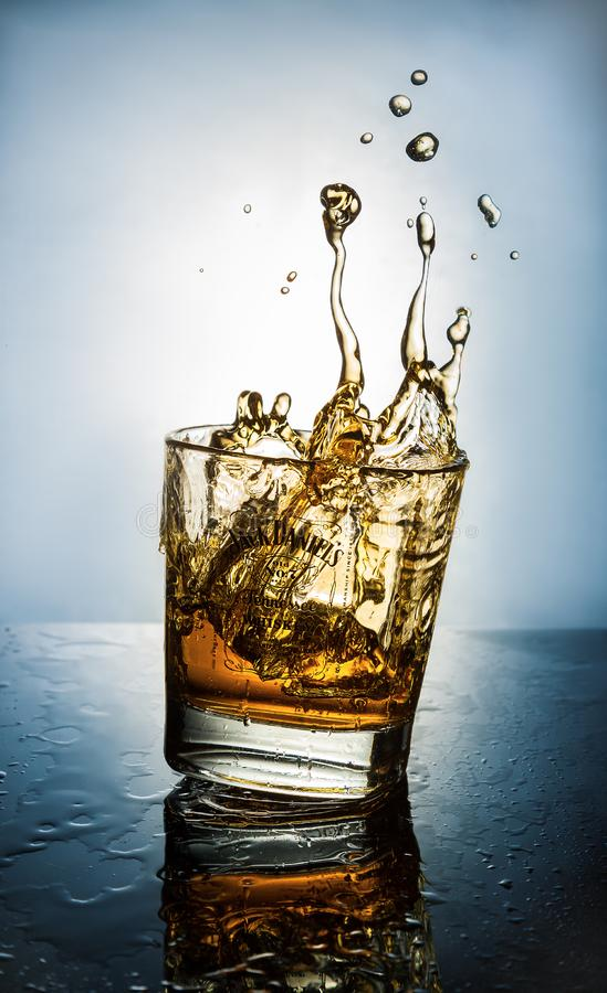 Whiskey splash. Jack Daniels stock photos