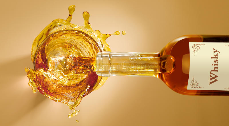 A splash of whisky stock image
