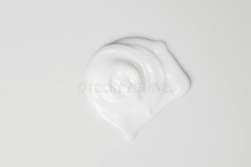 Splash of white cream. Splash of cream on the white background royalty free stock image