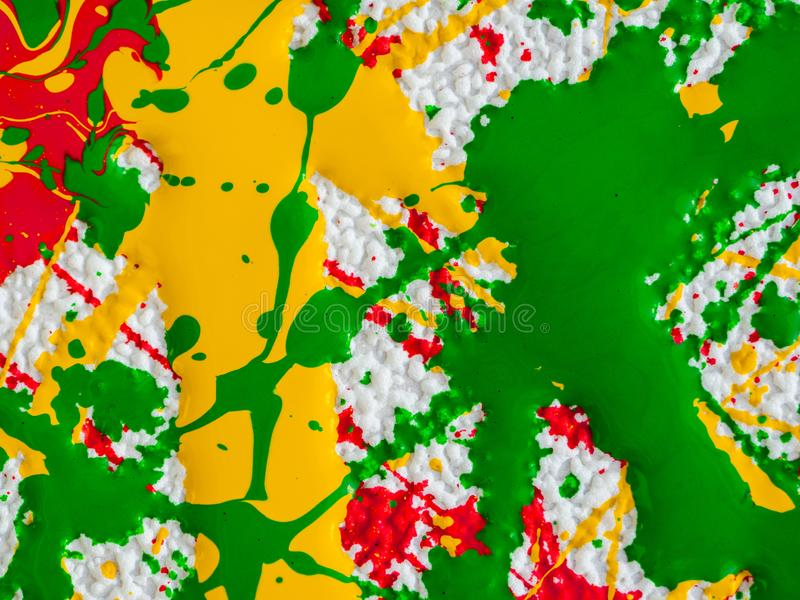 Splashes of red and yellow green paint on a white background royalty free stock photo