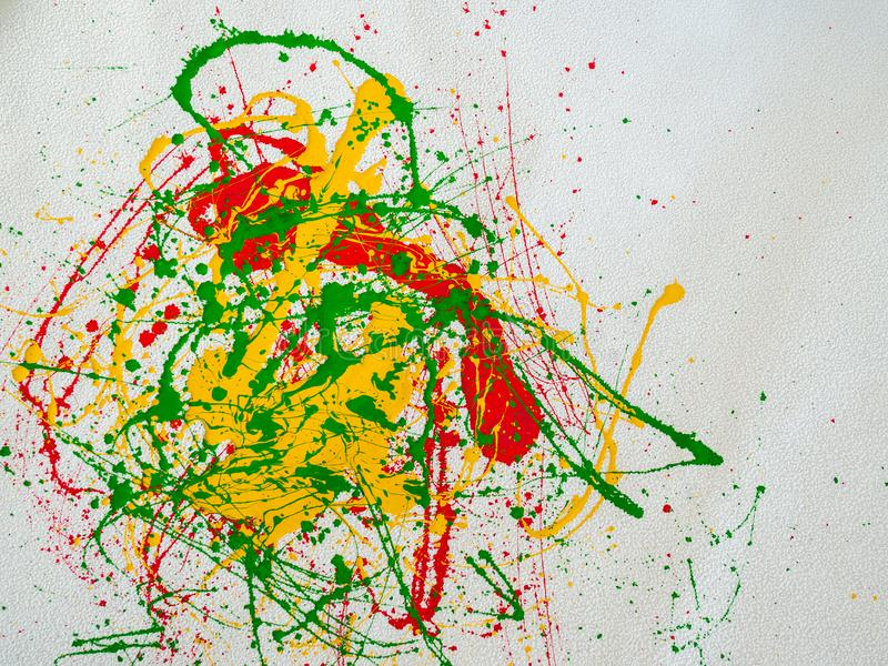 Splashes of red and yellow green paint on a white background royalty free stock photos