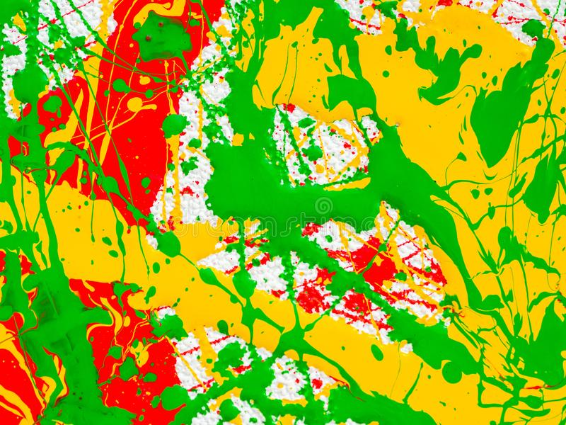 Splashes of red and yellow green paint on a white background royalty free stock images