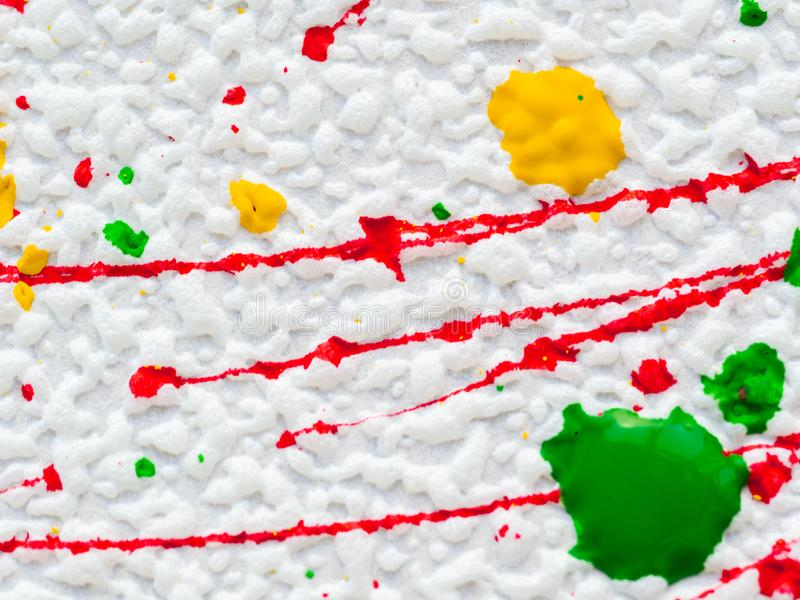 Splashes of red and yellow green paint on a white background royalty free stock image