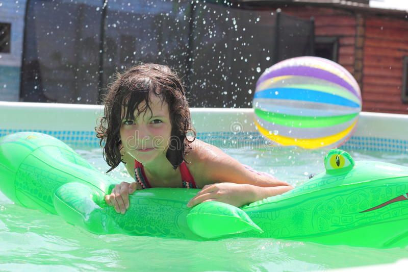 Splashes of summer. Girl in the pool enjoying the cool sea water. child on summer vacations. joy and emotion stock photo