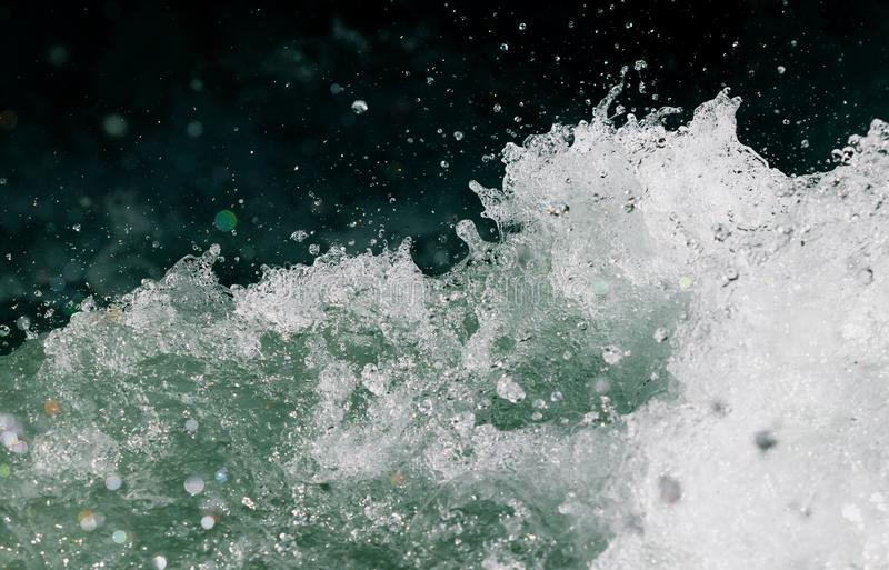 Splashes of water from the waves in the sea stock photography