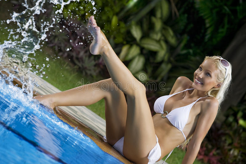 Splashing. Portrait of young attractive woman having good time in tropic environment stock images