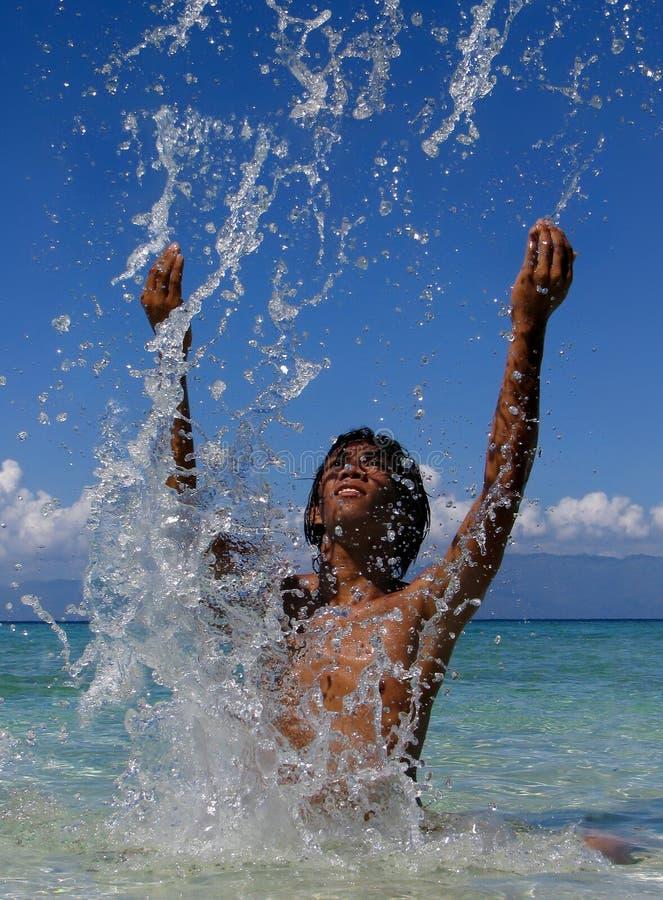 Free Splashing Exotic Boy Stock Image - 2786641