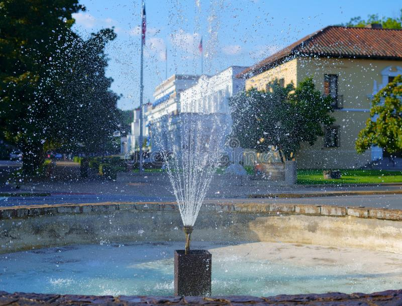 Splashing fountain in Hot Springs, Arkansas, USA. Beautiful fountain in famous Bathhouse Row, downtown historic Hot Springs, Arkansas, USA royalty free stock photos