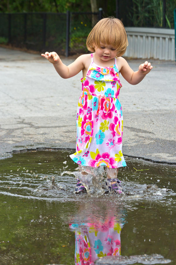 Splashing Girl Puddle Jumper stock photography
