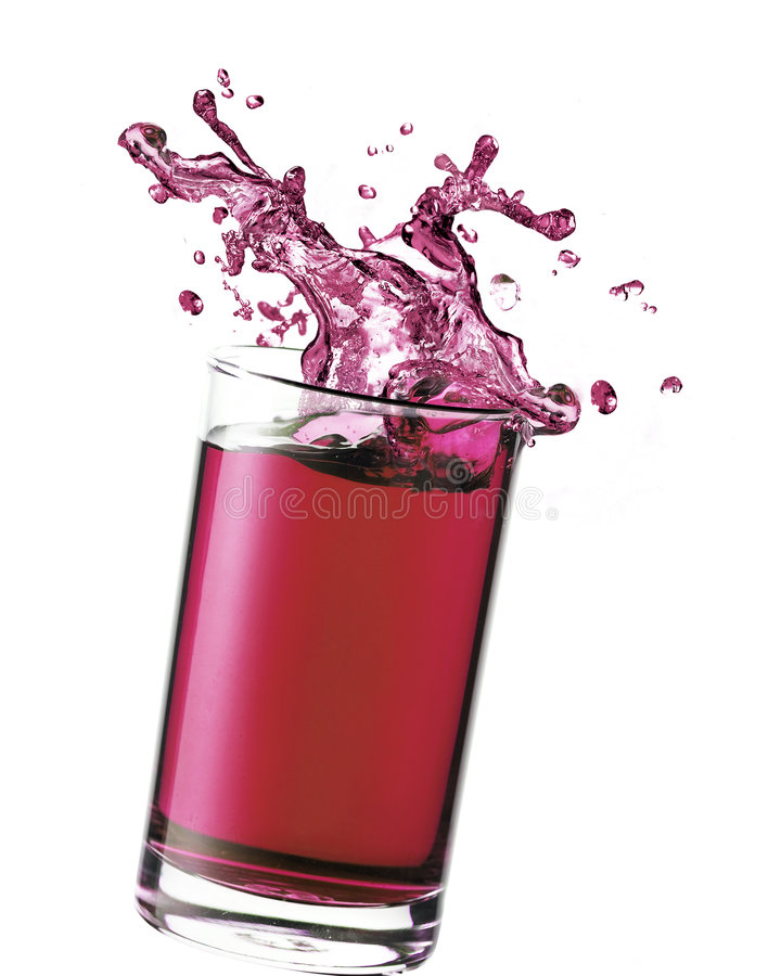 Splashing Juice. In a glass royalty free stock photography