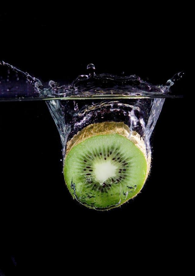 Splashing Kiwi royalty free stock photos