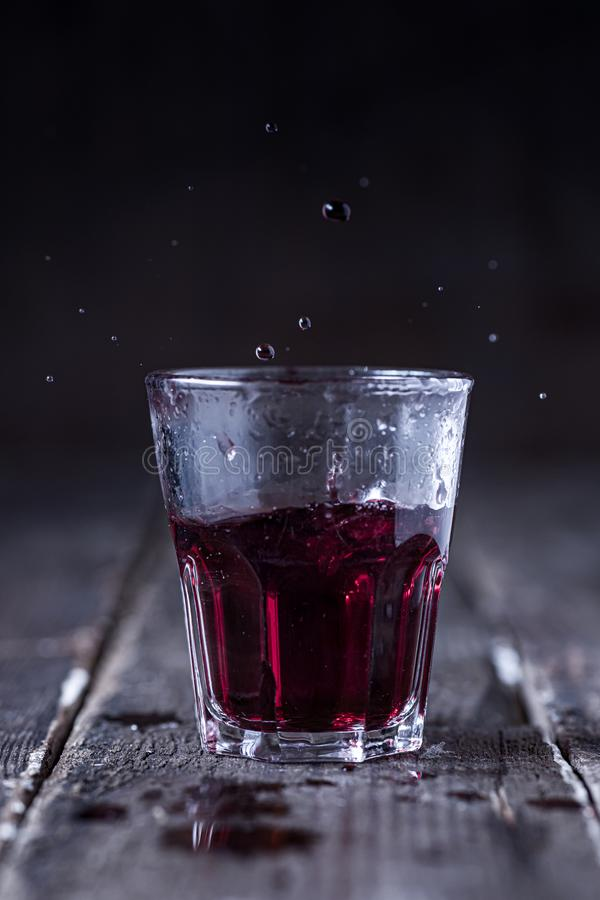 Splashing Liquor in a Glass Shot royalty free stock photos