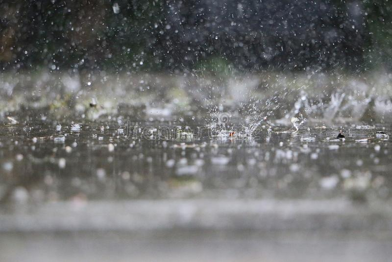 Close Up Of Falling And Splashing Rain On The Street Stock Image Image Of Storm Reflection 154395947