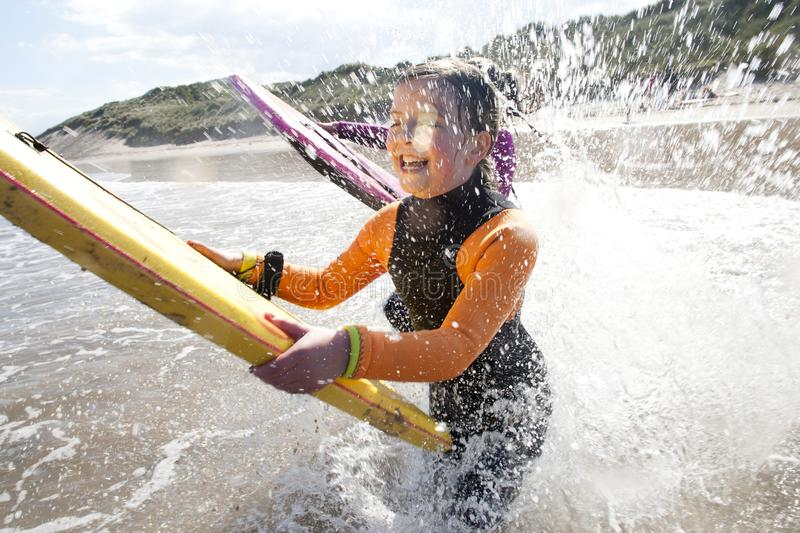 Splashing in the sea with Bodyboards stock photography