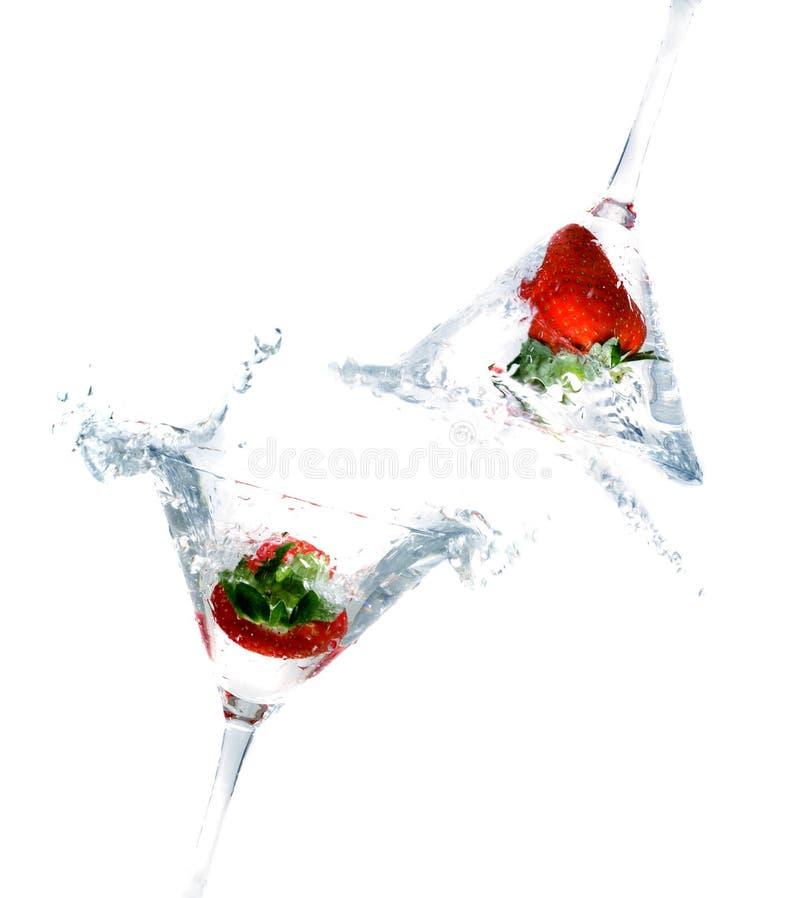 Splashing strawberry royalty free stock photo