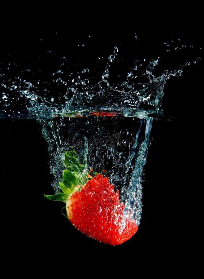 Splashing Strawberry royalty free stock image