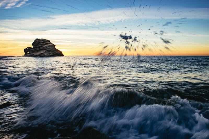Splashing surf and breaking waves at sunset royalty free stock photos