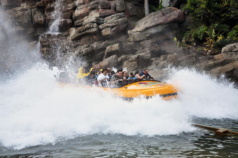 Splashing Water Ride At Theme Park Editorial Stock Photo