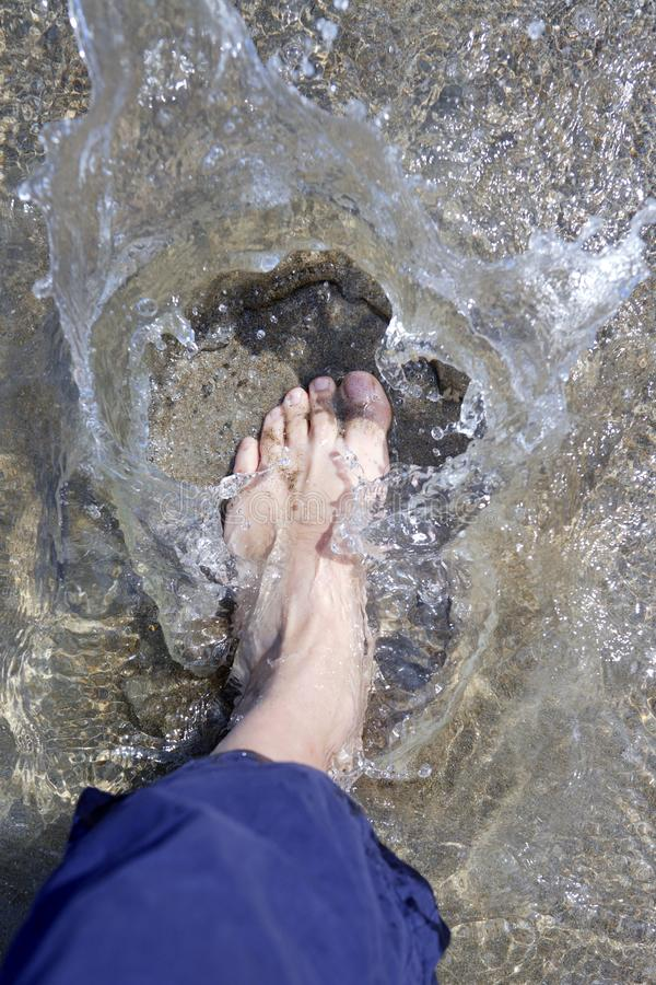 Download Splashing Water Tourist Feet On Beach Shore Stock Photo - Image: 14561654