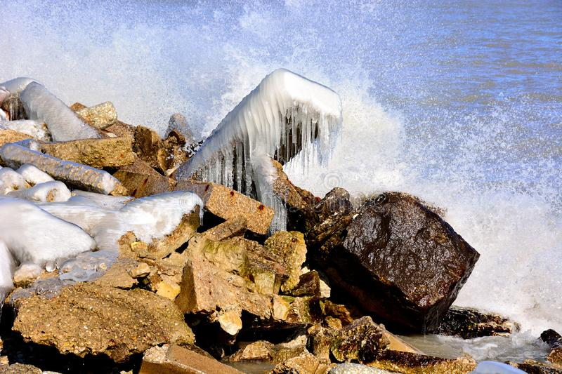 Splashing Waves Cause Beautiful Ice Formations royalty free stock photography