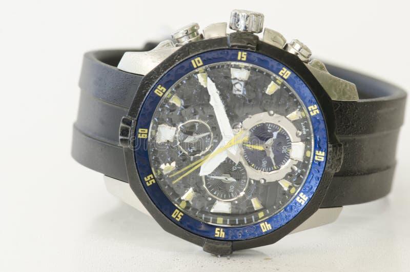 Splashy black and blue watch isolated. On white background stock photos