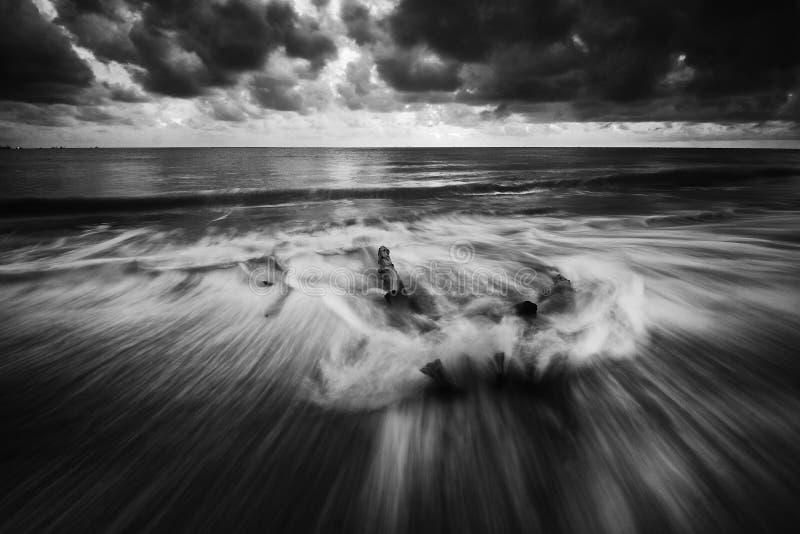 Splashy waves on beach royalty free stock photo