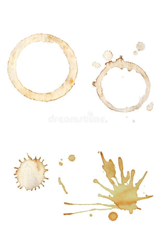 Splatters do café e anéis do copo fotografia de stock