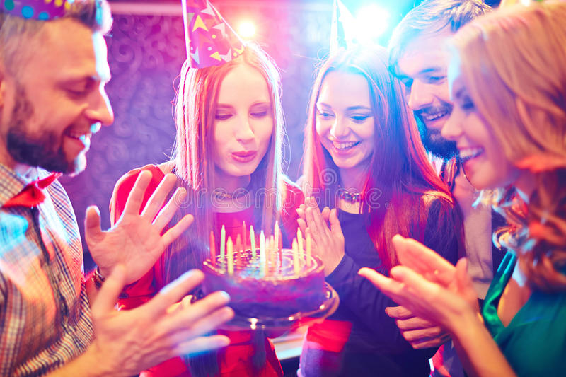 Splendid birthday party. Young people congratulating a women with birthday stock photography