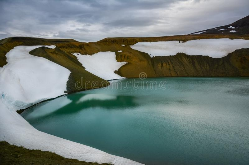Splendid view of famous crater Viti at Krafla geothermal area in summer with snow present.  Myvatn region, North part of Iceland royalty free stock images